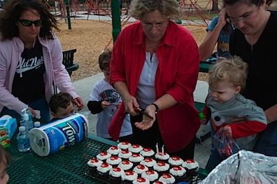 Grandma Jo helping light the candles on the cupcake! :)